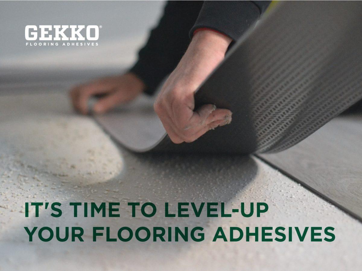 Hands adhering laminate flooring to the ground